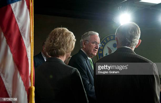Tammy Baldwin DWI Sen Tom Harkin DIA and Senate Majority Leader Harry Reid DNV during a press conference in the Senate before the vote on the...