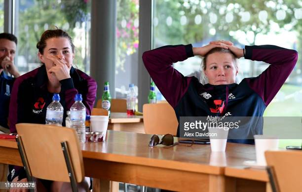 Tammy Beaumont and Anya Shrubsole of England react to England men going to a Super Over in the Final of the ICC Cricket World Cup Final against New...