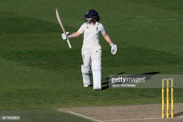 Tammy Beaumont of England celebrates after reaching her half century during the Women's Test match between Australia and England at North Sydney Oval...