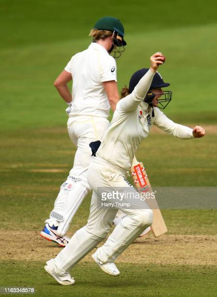 Tammy Beaumont of England celebrates after taking a catch to dismiss Beth Mooney of Australia during Day Four of the Kia Women's Test Match between...