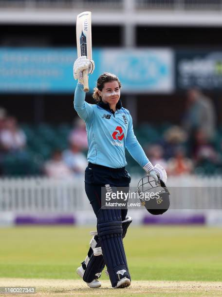 Tammy Beaumont of England celebrates her century during the 2nd Royal London Women's ODI match between England and Australia at Fischer County Ground...