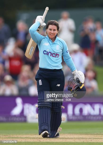 Tammy Beaumont of England celebrates her century during the 5th One Day International match between England and New Zealand at The Spitfire Ground on...