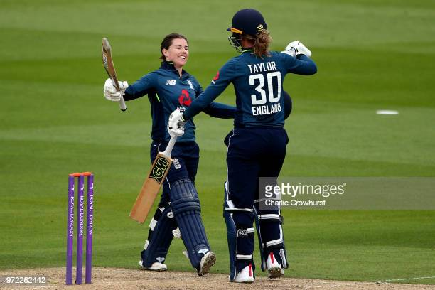 Tammy Beaumont of England celebrates her century with team mate Sarah Taylor during the ICC Women's Championship 2nd ODI match between England Women...