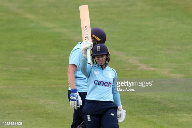 Tammy Beaumont of England celebrates reaching 100 runs during the Women's First One Day International between England and India at Bristol County...