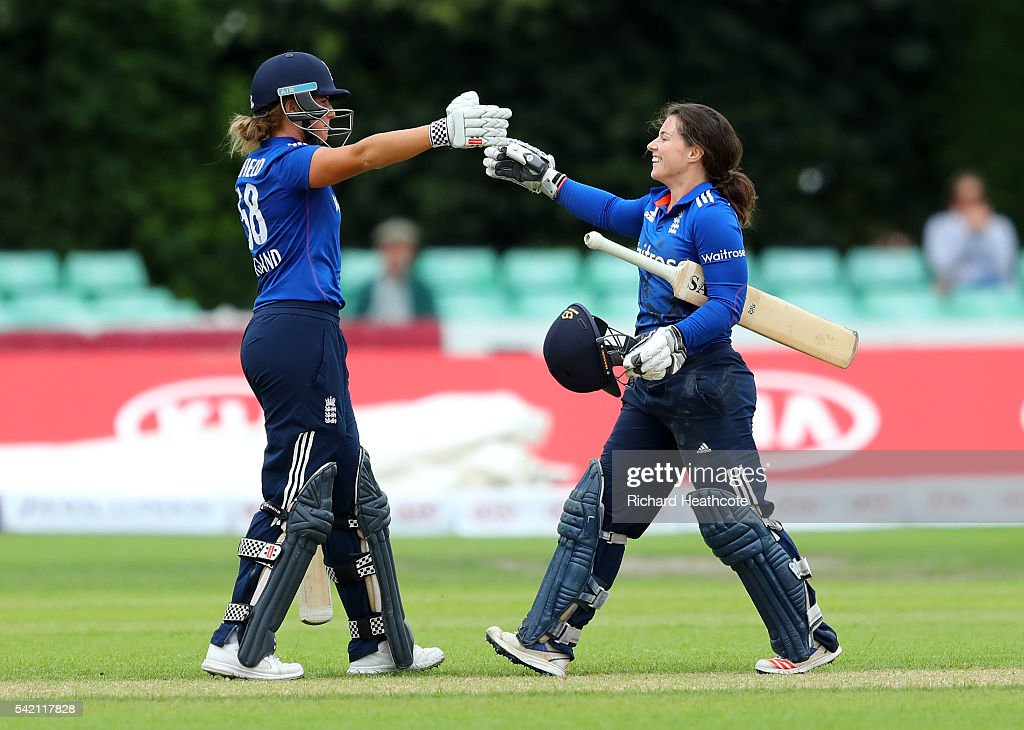 Tammy Beaumont of England (r) is congratulated by Lauren Winfield as she reaches her century during the second Women's Royal London ODI match between England and Pakistan at New Road on June 22, 2016 in Worcester, England.