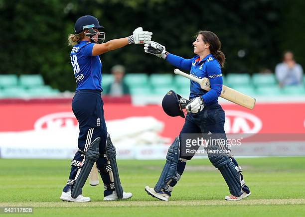 Tammy Beaumont of England is congratulated by Lauren Winfield as she reaches her century during the second Women's Royal London ODI match between...
