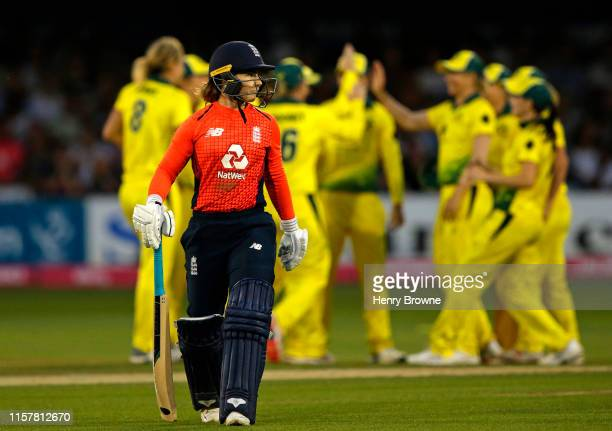 Tammy Beaumont of England walks off after being caught out during the England v Australia 1st Vitality Women's IT20 match at Cloudfm County Ground on...