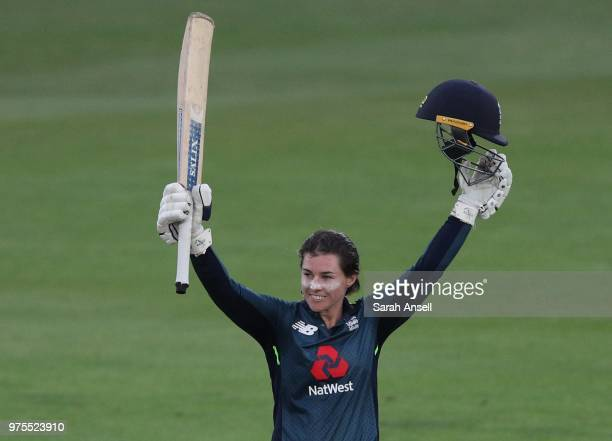 Tammy Beaumont of England Women raises her bat after reaching a century during the 3rd ODI of the ICC Women's Championship between England Women and...