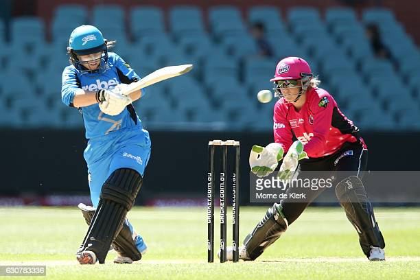 Tammy Beaumont of the Adelaide Strikers bats in front of Alyssa Healy of the Sydney Sixers during the WBBL match between the Sixers and Strikers on...