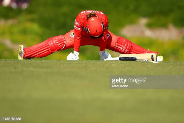 Tammy Beaumont of the Renegades stretches to maker ground during the Women's Big Bash League match between the Adelaide Strikers and the Melbourne...