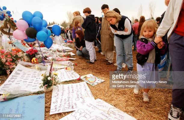 APRIL 24 1999 LITTLETON CO Tammy Crow right was among the thousands who viewed the memorial to the Columbine High School shooting victims at Clement...