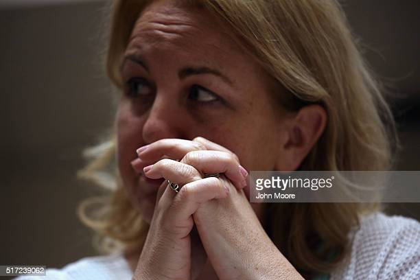 Tammy de la Cruz who's son is a recovering heroin addict listens during a family addiction support group on March 23 2016 in Groton CT The group she...