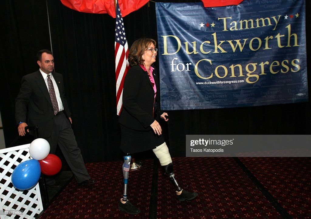 Tammy Duckworth and her husband Bryan Bowlsbey walk on stage, after conceding the Sixth District Congressional seat to Republican Peter Roskam on November 7, 2006 in Oakbrook, Illinois. Duckworth is a former helicopter pilot who lost both of her legs in Iraq.
