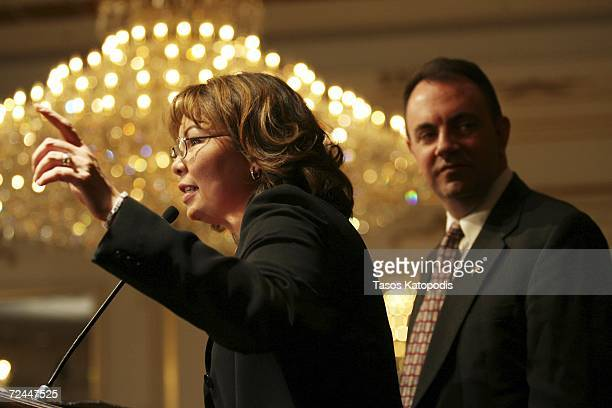 Tammy Duckworth concedes the Sixth District Congressional seat to Republican Peter Roskam as her husband Bryan Bowlsbey listens on November 7 2006 in...