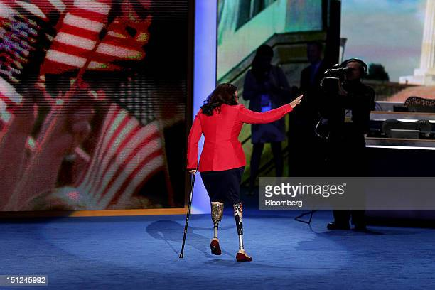 Tammy Duckworth Democratic candidate for Representative of Illinois waves after speaking at the Democratic National Convention in Charlotte North...