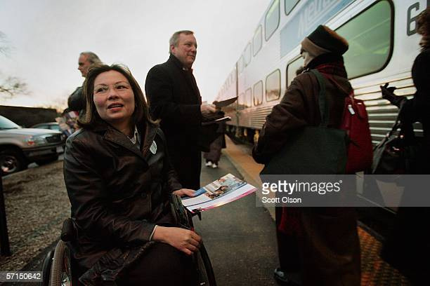Tammy Duckworth Democratic candidate for the 6th congressional district in Illinois campaigns with US Senator Dick Durbin at a commuter train stop...