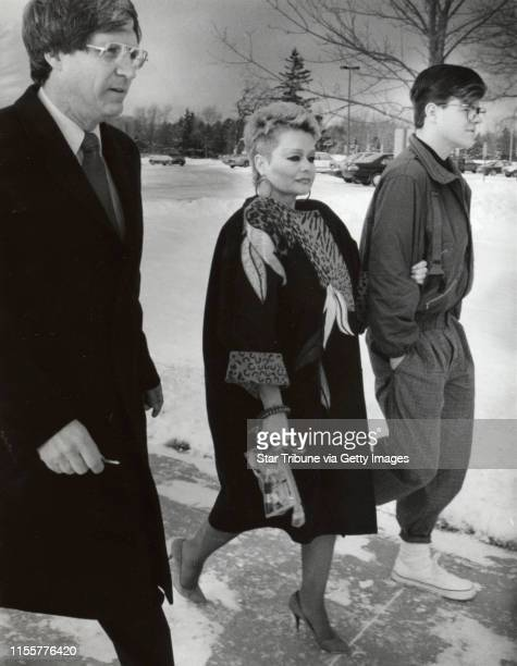 Tammy Faye Bakker holds the arm of her son Jamie Bakker as they walk to the prison in Rochester Minnesota to visit her husband former televangelist...