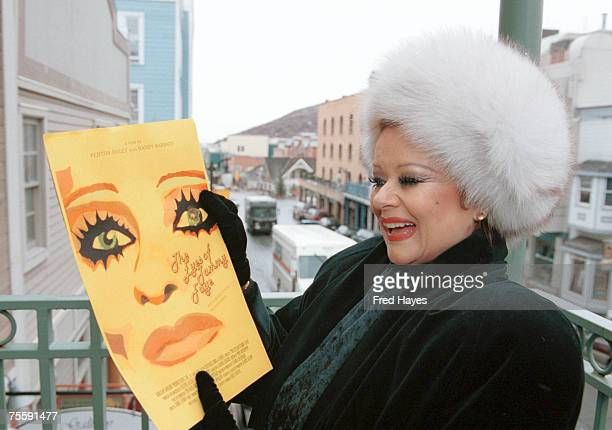 Tammy Faye Bakker Messner looks at a poster of the documentary filmThe Eyes Of Tammy Faye on a balcony overlooking Main Street in Park City Utah on...