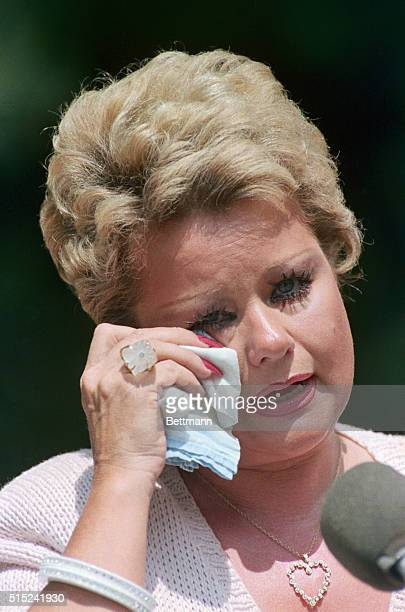 Tammy Faye Bakker wipes a tear from her eye as she speaks with news media outside of her home 6/17 Bakker said she and husband Jim would fight for...