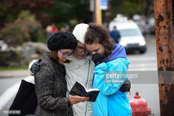 Tammy Hepps Kate Rothstein and her daughter Simone Rothstein pray from a prayerbook a block away from the site of a mass shooting at the Tree of Life...