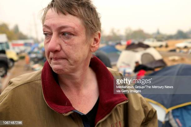 Tammy Mezera ponders an uncertain future at a growing tent city of homeless Camp Fire victims living in the parking lot of a Chico Calif Walmart on...