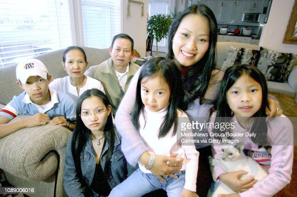 Tammy Nguyen holds her daughters Amanda Vo at right Samantha Vo with sister Kelly Nguyen son Tony Vo and her mom and dad Nga and Tue Nguyen in...