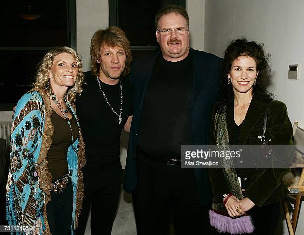 Tammy Reid singer Jon Bon Jovi football coach Andy Reid and an unidentified guest attend Kenneth Cole's RSVP to HELP benefit hosted by Kenneth Cole...