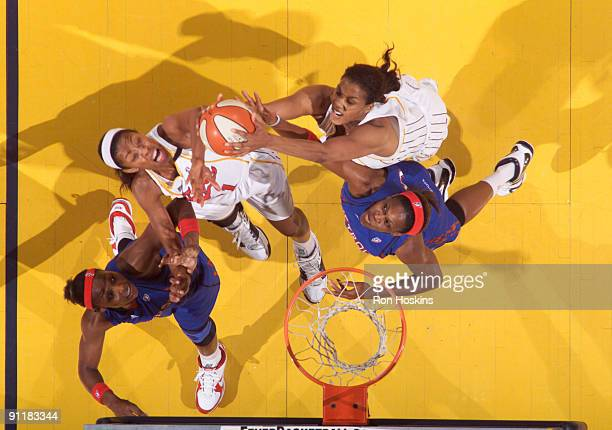 Tammy SuttonBrown and Jessica Moore of the Indiana Fever battle Cheryl Ford and Taj McWilliams of the Detroit Shock during Game Three of the WNBA...