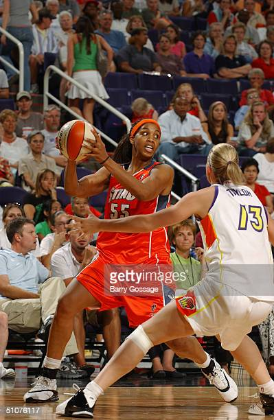 Tammy SuttonBrown of the Charlotte Sting looks to make a play against Penny Taylor of the Phoenix Mercury during a WNBA game played on June 11 2004...