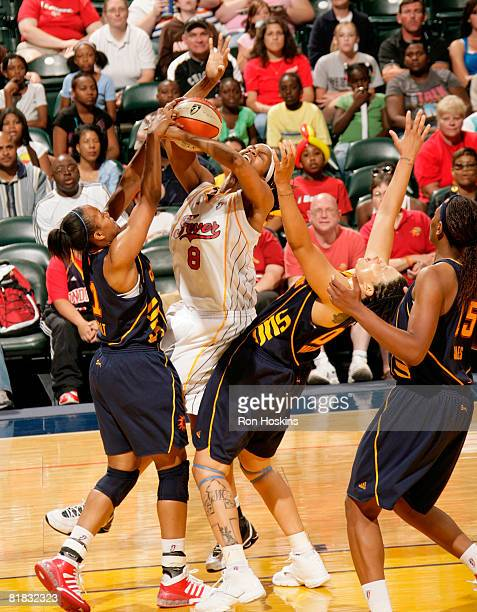 Tammy SuttonBrown of the Indiana Fever batles Tamika Whitmore and Amber Holt of the Connecticut Sun at Conseco Fieldhouse on July 5 2008 in...