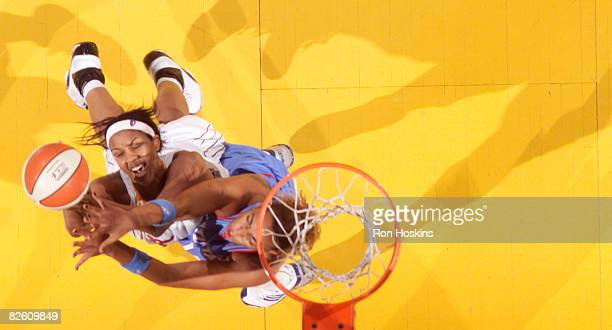 Tammy SuttonBrown of the Indiana Fever battles Erika de Souza of the Atlanta Dream at Conseco Fieldhouse on August 30 2008 in Indianapolis Indiana...
