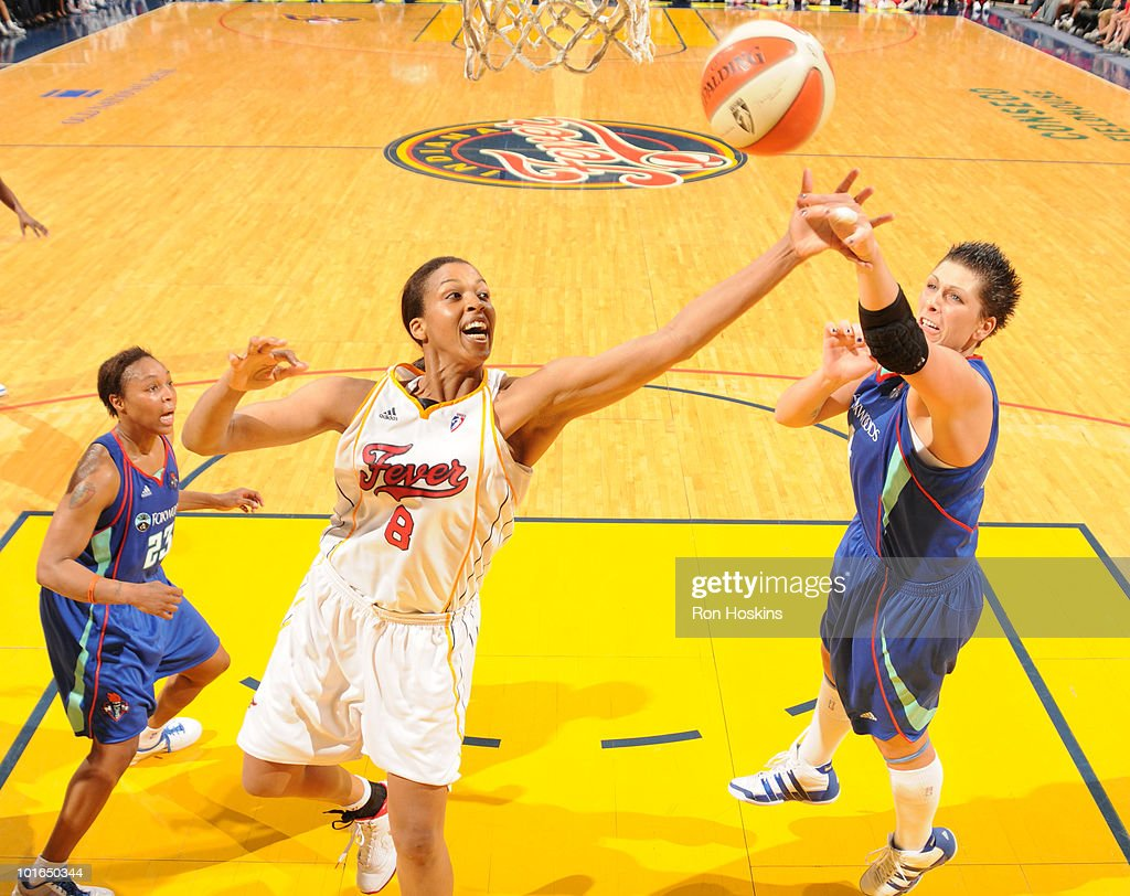 Tammy Sutton-Brown #8 of the Indiana Fever battles Janel McCarville #4 and Cappie Pondexter #23 of the New York Liberty at Conseco Fieldhouse on June 5, 2010 in Indianapolis, Indiana.