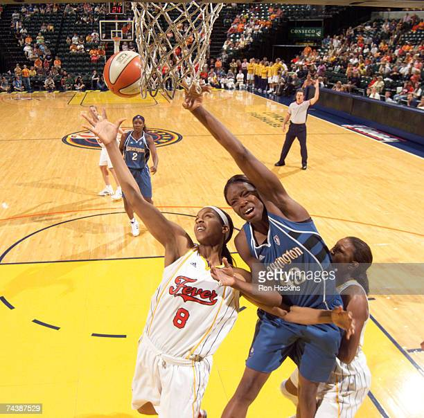 Tammy SuttonBrown of the Indiana Fever battles Nakia Sanford of the Washington Mystics at Conseco Fieldhouse June 3 2007 in Indianapolis Indiana The...