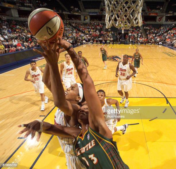 Tammy SuttonBrown of the Indiana Fever battles Yolanda Griffth of the Seattle Storm at Conseco Fieldhouse on July 18 2008 in Indianapolis Indiana...