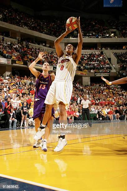 Tammy SuttonBrown of the Indiana Fever shoots against Penny Taylor of the Phoenix Mercury during Game Four of the WNBA Finals on October 7 2009 at...