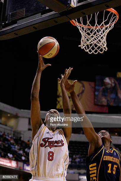Tammy SuttonBrown of the Indiana Fever shoots over Asjha Jones of the Connecticut Sun at Conseco Fieldhouse on August 28 2008 in Indianapolis Indiana...