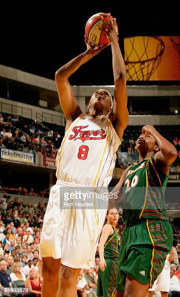 Tammy SuttonBrown of the Indiana Fever shoots over Camille Little of the Seattle Storm at Conseco Fieldhouse on July 18 2008 in Indianapolis Indiana...