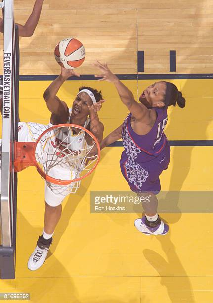 Tammy SuttonBrown of the Indiana Fever shoots over Laura Harper of the Sacramento Monarchs at Conseco Fieldhouse June 24 2008 in Indianapolis Indiana...