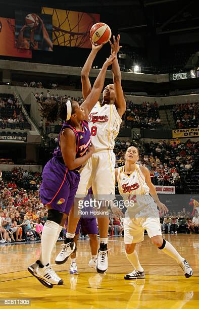 Tammy SuttonBrown of the Indiana Fever shoots over Le'coe Willingham of the Phoenix Mercury at Conseco Fieldhouse September 14 2008 in Indianapolis...