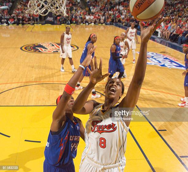 Tammy SuttonBrown of the Indiana Fever shoots over Taj McWilliams of the Detroit Shock during Game Three of the WNBA Eastern Conference Finals at...