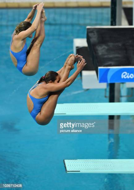 Tammy Takagi an Pamela Veloso of Brazil compete during the Women's Synchronised 3m Springboard Swimming event of the Rio 2016 Olympic Games at the...