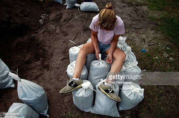 Tampa area residents make preparations for the arrival of Tropical Storm Issac by filling sandbags at a Hillsborough County Public Works Service...