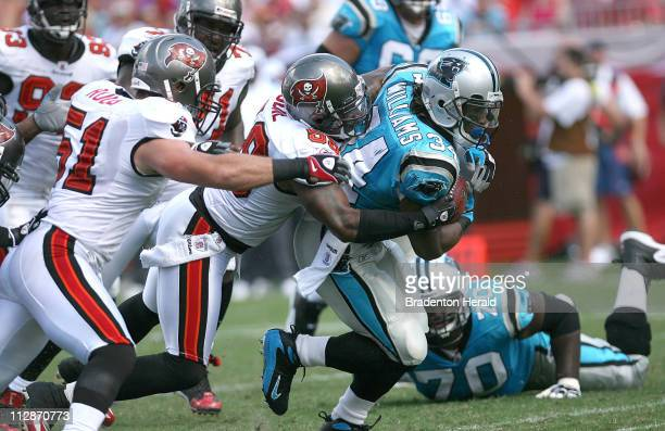 Tampa Bay Buccaneers' Cato June brings down Carolina Panthers' DeAngelo Williams short of a first down The Bucs defeated the Panthers 273 at Raymond...