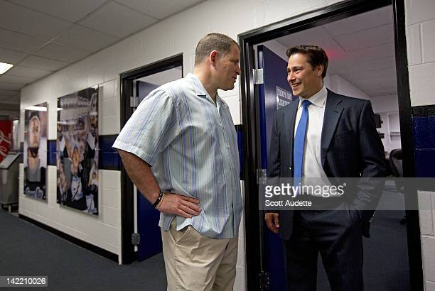 Tampa Bay Buccaneers coach Greg Schiano meets Guy Boucher of the Tampa Bay Lightning before the start of the game against the Winnipeg Jets at the St...