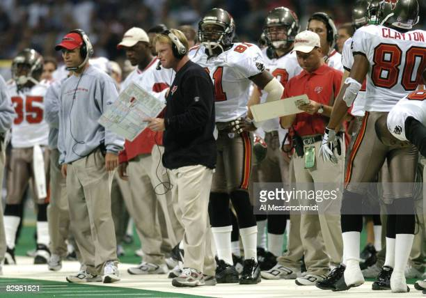 Tampa Bay Buccaneers coach Jon Gruden watches play against the St Louis Rams October 18 2004 at the Edward Jones Dome in St Louis The Rams defeated...