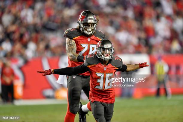 Tampa Bay Buccaneers cornerback Robert McClain and Tampa Bay Buccaneers defensive end Patrick O'Connor celebrate a blocked field goal attempt during...