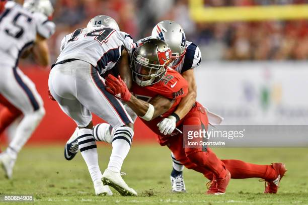 Tampa Bay Buccaneers cornerback Robert McClain tackles New England Patriots wide receiver Brandin Cooks during an NFL football game between the New...