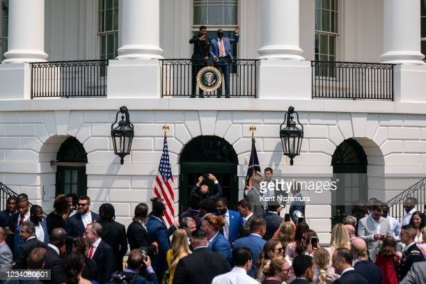 Tampa Bay Buccaneers cornerback Sean Murphy-Bunting and running back Leonard Fournette wave from the White House South Portico Balcony after...