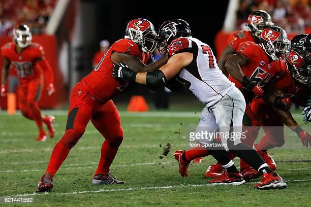 Tampa Bay Buccaneers defensive end Robert Ayers and Atlanta Falcons tackle Jake Matthews in action during the NFL game between the Atlanta Falcons...