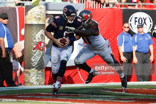 Tampa Bay Buccaneers defensive end Robert Ayers forces a safety as he reaches Chicago Bears quarterback Jay Cutler in the end zone during the 3rd...